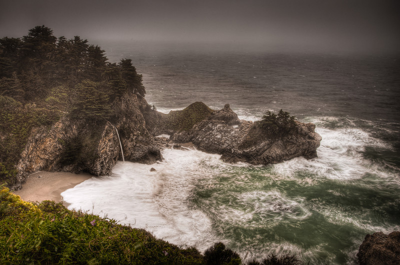 McWay Falls I<br /> <br /> This was one of the hardest photos I have ever taken. Normally a peaceful scene, the overlook for McWay Falls was being hammered by 60+MPH winds and a hard driving rain this day. I covered my camera & tripod with plastic bags & towels and waited for a break to get this one shot. Then I climbed back into my truck drenched from head to toe. <br /> McWay Falls, Julia Pfeiffer Burns State Park, Big Sur, California, USA