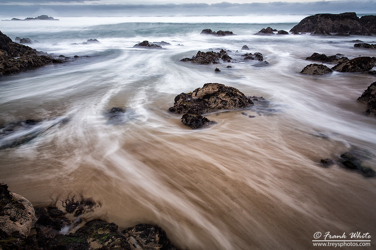 Tides and sand at Bean Hollow state beach, south of San Francisco, CA
