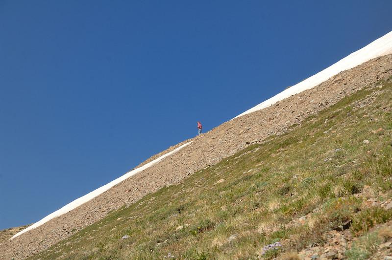 Hiker reaching the saddle