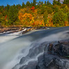 At The Base Of The Falls With Backdrop Of Autumn