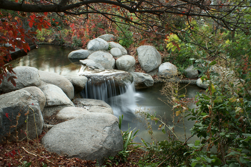 Small waterfall/water flowing over rock.