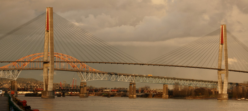 The Pattullo Bridge and the Skytrain Bridge in New Westminster BC at sunset.