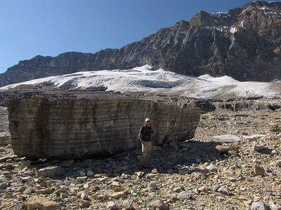 Dawn and huge boulder along the Iceline Trail in Yoho National Park. Note the layers of ancient ocean sediment.