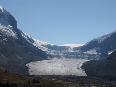 Athabasca Glacier with Mount Andromeda to the left and the Columbia Icefield in the background. The glacier is the headwaters of the Athabasca River, which eventually drains into the Arctic Ocean.