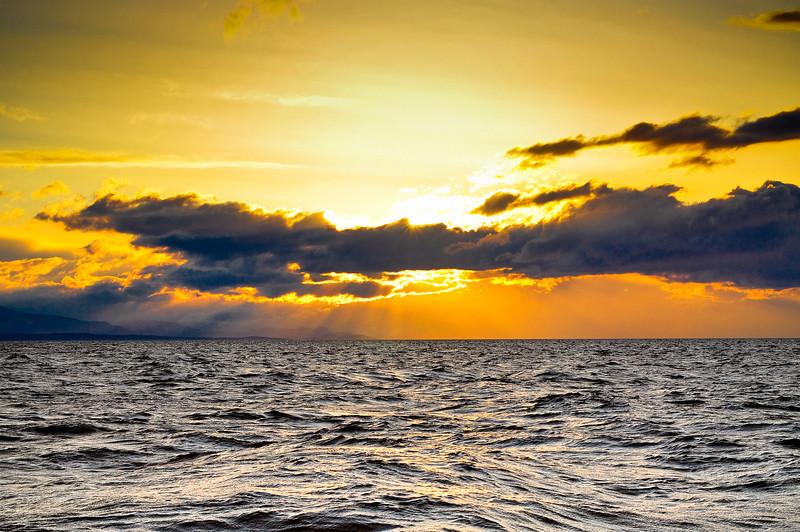 Sun rise over a choppy sea