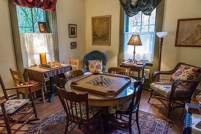 A sitting room. Note the drapes are tartans.