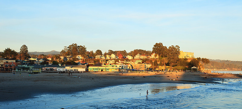 A swimmer races to take a plunge in the cold waters of Capitola.
