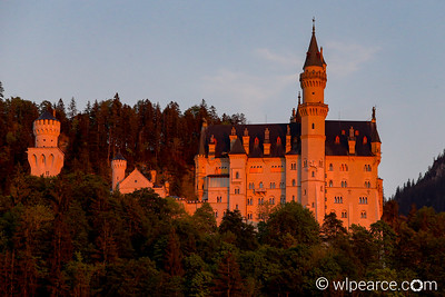 Neuschwanstein bathed in the sunset's glow