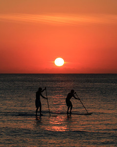 Paddle boarders at Sunset in the Cayman Islands on 7 Mile Beach 12-29-12.