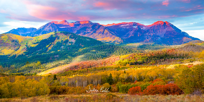 "Mt Timpanogos<br /> Utah's Alpine Loop<br /> October 2, 2016 --  Sunrise<br /> <br /> This shot was taken near The Sundance Kid's Place off of Utah's Alpine Loop scenic drive which leads to Cascade Springs.  <br /> <br /> Mt Timpanogos is the prominent feature in the area and, it seems, it can be tough to compose a shot without it.  This is a beautiful part of the country and can be a real treat to see in the fall.<br /> <br /> We were on this Forest Road in the dark, in an effort to gain a little elevation to compose an expansive landscape shot at sunrise, when we encountered a group of hunters hobnobbing around a campfire.  <br /> <br /> Asked about how much farther the road goes before it ends, and after replying, one guy asked us what we were hunting?  I said:  ""We're hunting photos,"" and he said ""what,"" to which I replied,  ""we're shooting pictures!""  Well, they got a kick out of that.  :)<br /> <br /> We selected a spot to shoot from and enjoyed a colorful sunrise which really only lasted about 2 minutes.  Oh but what marvelous couple of minutes!<br /> <br /> A good view of Mt Timpanogos framed by a wonderful fall palate."