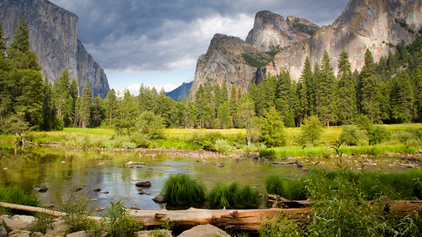 Yosemite's Valley View Turnout<br /> Time of day:  mid-day<br /> Date:  August 7, 2009<br /> <br /> While en route to Tuolumne Meadows we stopped for a while to take in Valley View (aka Gates of the Valley).  <br /> <br /> The sunlight was peeking through the clouds periodically so we did our best to catch it in the act.   The show from Bridalveil falls was over since this was taken in August and most of the snow had already melted and runoff - so no gushing waterfall here.<br /> <br /> We might have stayed here too long since it cut into our reconnaissance time at Tuolumne Meadows.   But it was a wonder to behold this scene as the light danced across the meadow periodically.<br /> <br /> A polarizer and 2 stop soft grad was used in this shot.