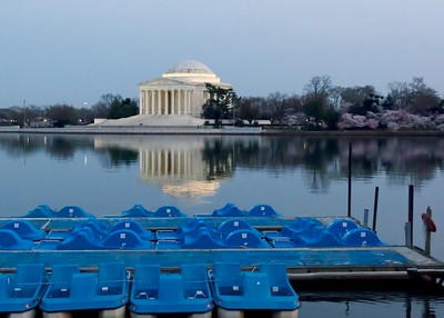 View of the Jefferson Memorial and the paddle boat near dawn at peak.