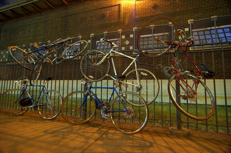 Bikes on a fence, Chicago. July.  Number 3.