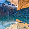 The glorious Torres Del Paine reflected in a glacial lake.