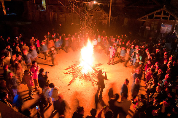 Sister festival in Guizhou. People dace around the fire.