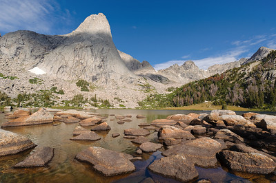 Pingora and boulders in Lonesome Lake. Cirque of the Towers, Wyoming. Photo by Mike Reid.