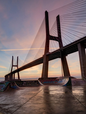 Vasco da Gama bridge, Lisbon, Portugal. With the decadent skatepark underneath, this very inspiring setting is very popular, and even as early as daybreak, one can always expect the company of other fellow photographers.