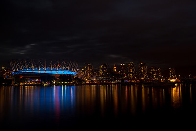 Looking across False Creek at the Vancouver skyline.  That's BC Place stadium all shiny and blue.