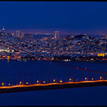 """""""Full Moon over the Golden Gate Bridge in the Marin Headlands""""  Last night turned out the be warm and clear with just enough particles in the atmosphere to give the moon a great red glow!  This is a 42 shot panorama with the Transamerica Pyramid through the North Tower of the Golden Gate Bridge."""