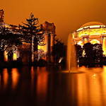 Palace of Fine Arts at Night in San Francisco.  I went up to San Francisco to attend the 20th anniversary of Photoshop which was at the Palace of Fine Arts.  I managed to get up there right at dusk and captured a few images.  The fog was pretty thick with the lights of the Palace of Fine Arts creating a glow in the sky.  This coupled with the nice reflections makes this is pleasing but almost fiery combination!