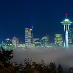 """Seattle Night Skyline in Fog"" I was up in Seattle and ventured out to get a shot or two of downtown Seattle. Unfortunately the fog was in pretty thick! This was one of the 3 shots I got with minimal fog. 5 minutes later you couldn't even see the Space Needle! Amazing view of an amazing city! Mount Rainier is supposed to be off in the distant but not this evening! Sunset from here must be amazing!    Copyright John Harrison Photography— in Seattle, Washington.    Kerry Park, Franklin Place, views of Elliott Bay and the Central City backdrop of Mount Rainier."