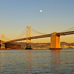 San Francisco Bay Bridge, Oakland Hills and Treasure Island under an almost Full Moon.