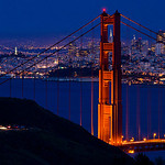 """""""Full Moon over the Golden Gate Bridge in the Marin Headlands"""" Last night turned out the be warm and clear with just enough particles in the atmosphere to give the moon a great red glow! This is part of a 42 shot panorama with the Gigapan Epic Pro with the Transamerica Pyramid through the North Tower of the Golden Gate Bridge. You can see the full panorama from end to end over here on my website. <a href=""""http://bit.ly/HyflLR"""">http://bit.ly/HyflLR</a> This is captured at 300mm with the Nikon D7000 (1.5x crop), .8 seconds, f/9, ISO 800. 42 images stitched in Autopano Pro Giga. (This is still low res as I haven't stitched the full 16 bit images yet)"""