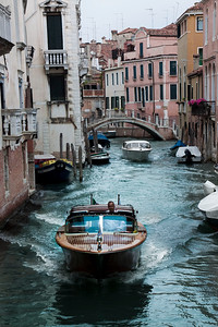 A boat navigates the canals of Venice, Italy 2010