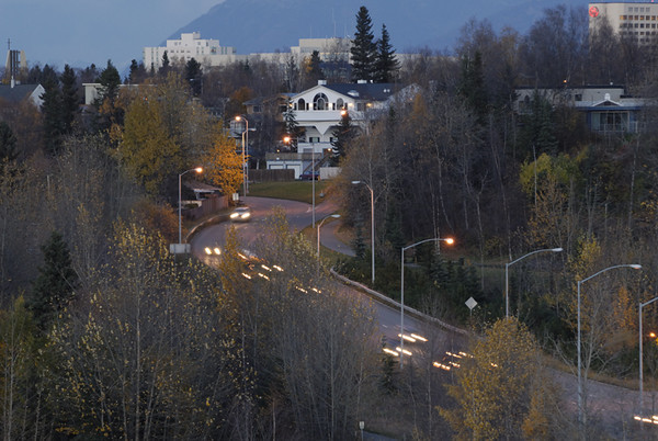 Traffic flowing from downtown Anchorage to the outlying areas at the end of the day. This photograph was taken from an overlook in mid-town in late September.