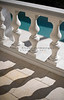 Stone balusters casting shadows.