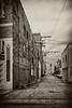 Duo-toned image of an alleyway in the beach town of Venice California.
