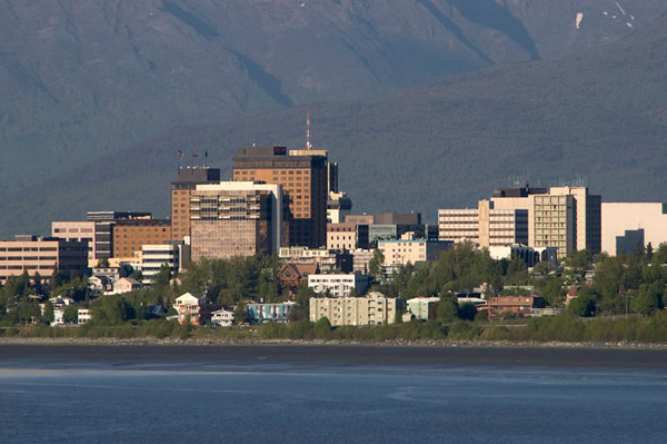 Taken across the looking across Cook Inlet at the skyline of Anchorage, Alaska from Earthquake Park. This photo was taken at the about mid-summer.