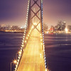 The view across the San Francisco Bay Bridge at twilight.