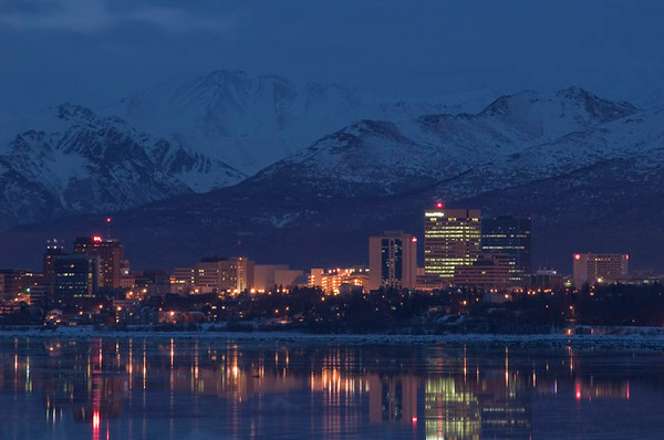 Anchorage, Alaska at dawn looking across Cook Inlet from Earthquake Park. This photograph was taken in December 2005.