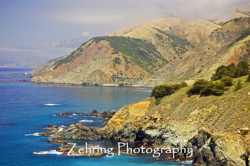 Wonderful vantage point of the California coast, south of Carmel. A view of one of the highway bridges in the distance.