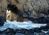 Sun rays filter through the arch at Pfeiffer Beach