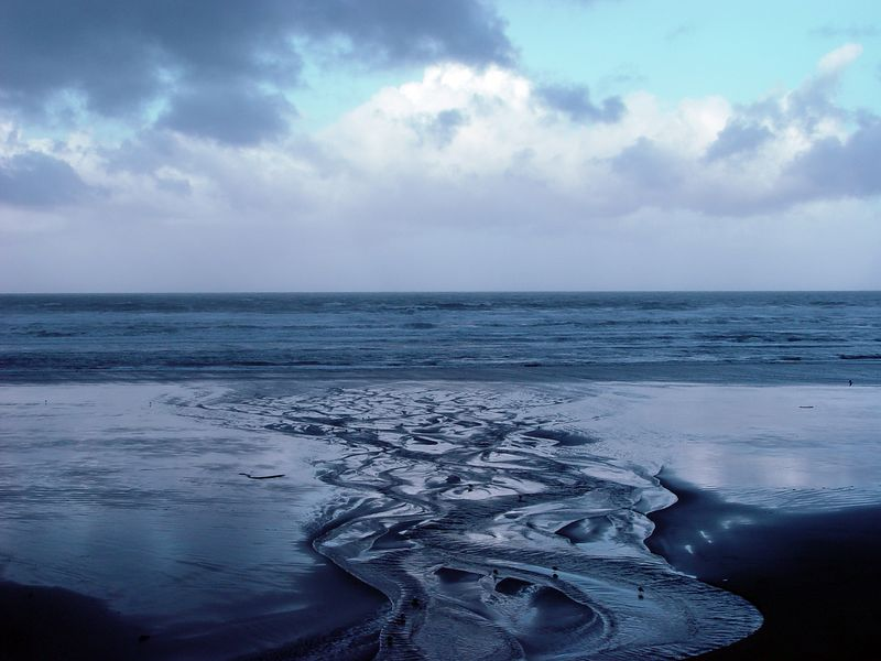 Freshwater creek etched designs in sand during the night after the tide went out.  Early morning photo at Cannon Beach.