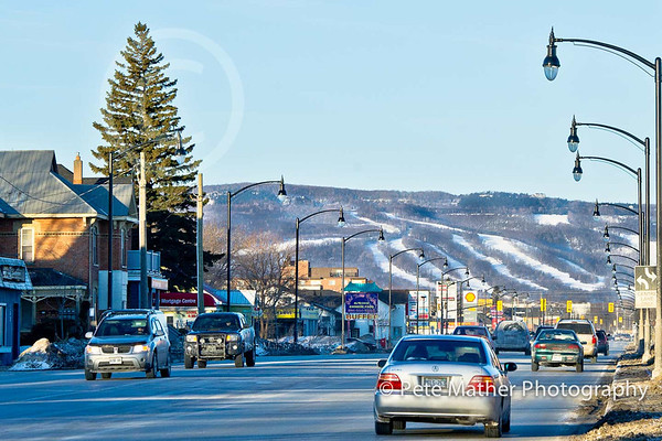 Downtown Collingwood on Highway #26 with the Ski Hills in the distance.
