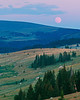 Moonrise, summer. Mountain meadow and lake