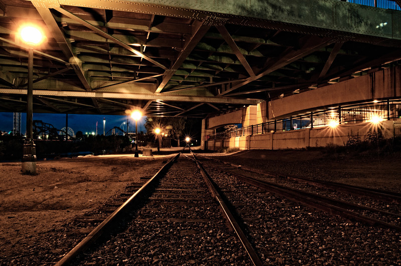 Railroad tracks going under the Speer Blvd.  bridge at Confluence Park near downtown Denver, Colorado.