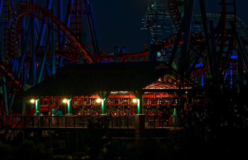 The twisting metal of roller coasters at Elitch Garden's Amusement Park, in the Denver night.