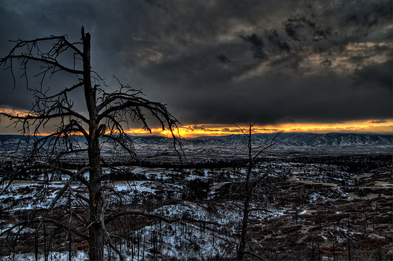 Sunset on a light snow in the Colorado Rocky Mountain foothills over the Daniels Park area.