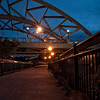 Night on the walking bridge at Confluence Park near downtown Denver, Colorado.