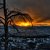 Fire in the sky, over a light snow in the Colorado Rocky Mountain foothills.