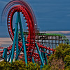 The roller coaster whips around the outside loop at Elitch Gardens Amusement Park in Denver, CO.