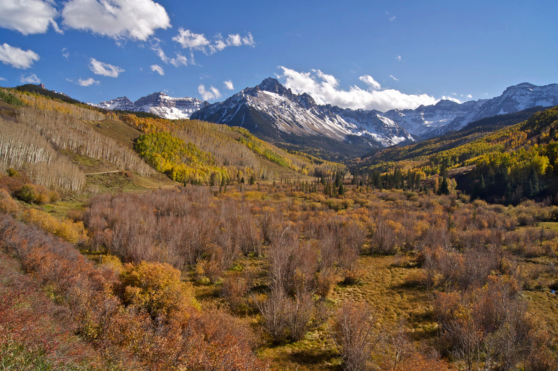 The colorful glacial valley along Dallas Creek lies along the northern approach to Mt. Sneffels; Colorado San Juan Mountains.