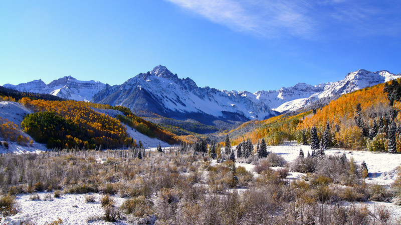 Morning frost covers the Dallas Creek valley on the northern approach to Mount Sneffels, Colorado San Juan Range.