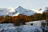 Early morning sun reveals autumn's first snow on a cattle ranch, Dallas Divide, Colorado San Juan Mountains.