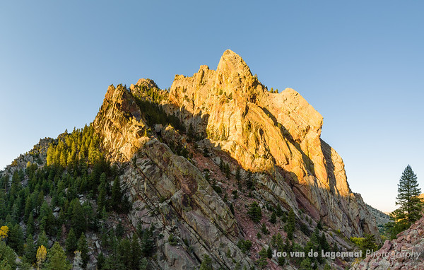 Monolith - sun sets on the back of the flatirons at Eldorado Canyon SP
