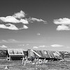 55  G Abandoned Barns Clouds BW